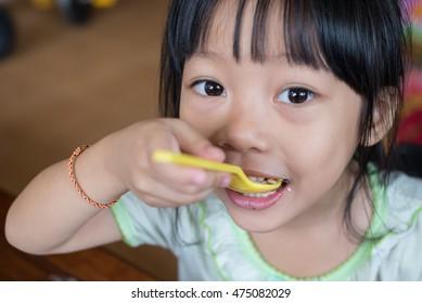 closeup Little girl eating rice