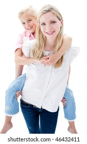 Close-up of little girl enjoying piggyback ride with her mother against a white background