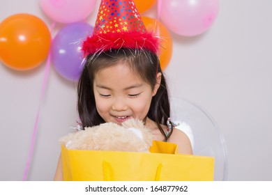 Close-up of a little girl with gifts at her birthday party