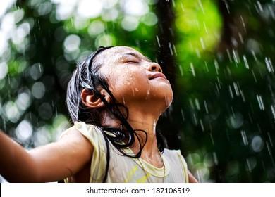 Closeup little girl in the summer rain
