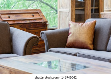 A closeup of a living room with couches and a coffee table