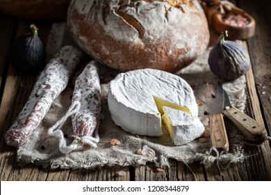 Closeup of load of bread with camembert cheese and sausage