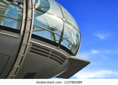 Closeup of London Eye capsule on blue sky