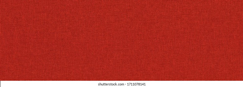 Close-up long and wide texture of natural red fabric or cloth in light red color. Fabric texture of natural cotton or linen textile material. Red canvas background.