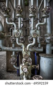A closeup look at a pipeline construction, with some beautiful symmetric lines. Shot taken at an abandoned power factory