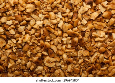 Closeup of lots of crushed roasted peanuts