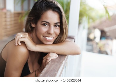 Close-up lovely tanned girlfriend pierced nose tanned skin lean handrail cafe terrace turn camera happily smiling thankful dream come true girl resting perfect tropical hotel, enjoy summer vacation