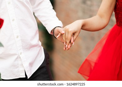 Closeup of loving couple holding hands. Love, Valentine and wedding concept. Just married couple showing rings and love. Top view. Advertising for wedding salon. Wedding banner. . horizontal
