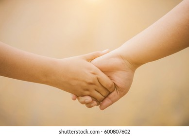 Closeup of loving couple holding hands