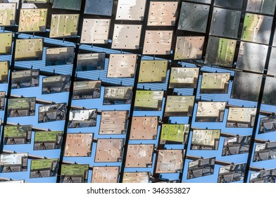 Closeup low angle view of Solar powered heliostat of motorised mirrors on high rise building at Sydney -Australia