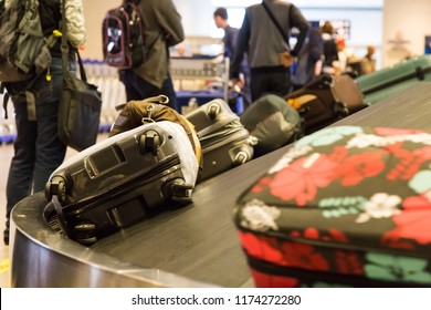 Closeup of luggage bag on airport conveyor belt for pickup