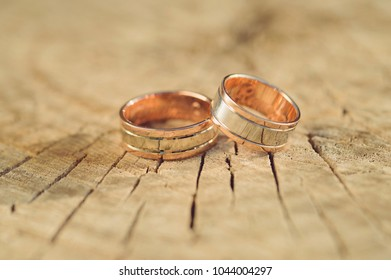 closeup of luxury golden rings on wood