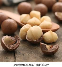Closeup of Macadamia nut on wooden table.