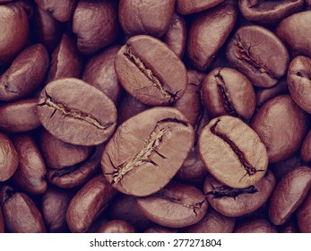 Closeup macro coffee beans background, retro instagram style filtered
