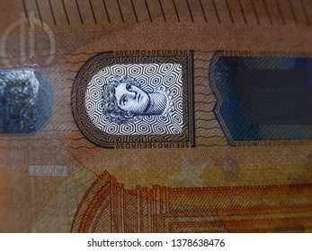 Closeup (macro) of hologram on a 50 euro bill. No front light, only backlight. Head of Europa mistress of god Zeus (Greek mythology, Europe series) to check the authenticity. Proof of genuineness.