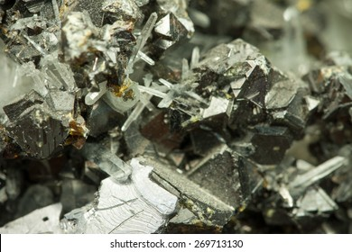 Closeup macro image of black lead zinc ore with irregular chaotic texture, symbolizing cold beauty of natural resources and custom approach of emergent generative algorithm spacial design