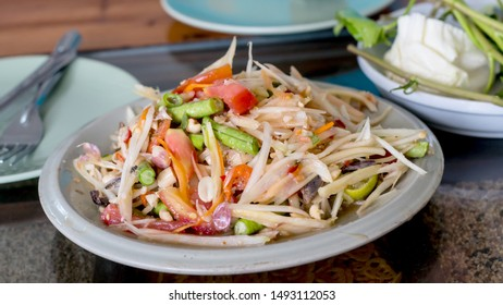 Close-up of Macro Papaya Salad from Thailand on the marble table background.