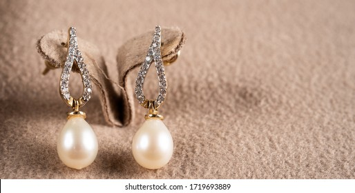 close-up macro photo pearl diamond earrings