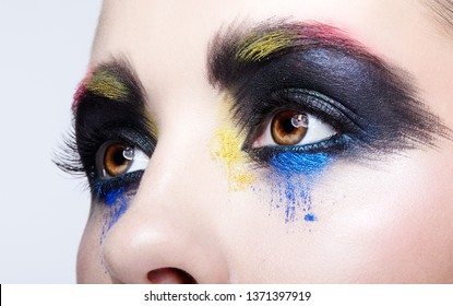 Close-up macro portrait of beautiful woman eye zone make up. Female eye with unusual artistic painting makeup.
