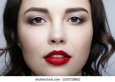 Closeup macro portrait of female face. Human woman face  with day beauty makeup. Girl with perfect skin.