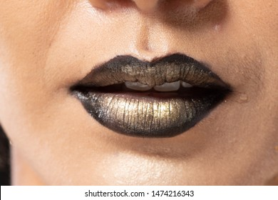 Closeup macro portrait of woman dark golden lip teeth, Young female open close mouth. Body Part of Fashion make up express emotion shape Lips with color Lipstick, studio lighting Gold leaf theme