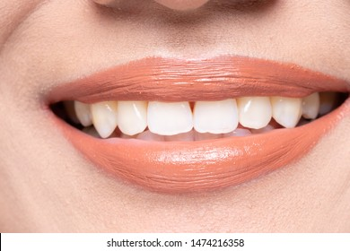 Closeup macro portrait of woman red pink lip teeth, Young female open close mouth. Body Part of Fashion make up express emotion shape Lips with color Lipstick, studio lighting