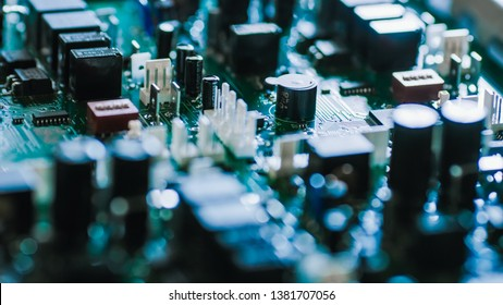 Close-up Macro Shot of Electronic Printed Circuit Board with Microchips, Transistors, Semiconductors, Capacitors on the Motherboard.