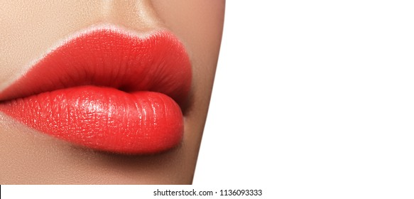Close-up macro shot of female mouth. Sexy Glamour red lips Makeup with sensuality gesture. Juicy gloss lipstick. Full lips