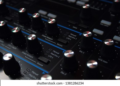 Close-up / macro shot of new modern studio synthesizer