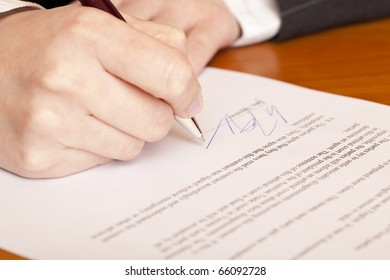 Close-up macro of signing a contract.