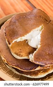 Closeup macro of stacked american pancakes stuffed with chocolate cream.