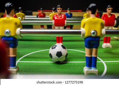 Closeup macro table-top game of foosball or table football with soccer ball