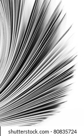 Close-up of magazine pages on white background. B&W image. Shallow DOF, focus on edges.