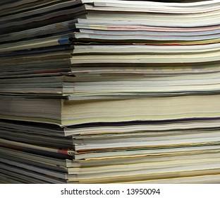 close-up of magazines pile