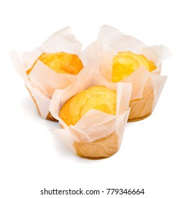 Closeup of a Magdalena Typical Spanish Plain Muffin. Sweet Food or Dessert. Three Fresh Baked Muffin Isolated on White Background in American Style. Irresistible Tasty Cake.