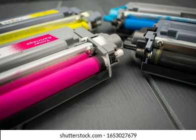 Close-up of magenta toner cartridge along with other yellow, black and cyan for laser printer