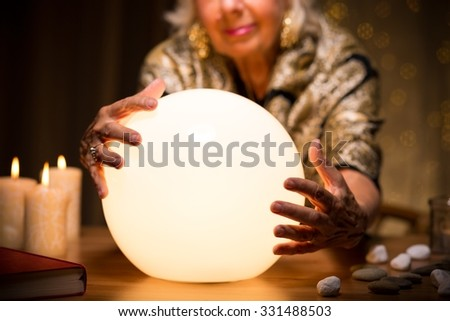Close-up of magic woman with crystal ball