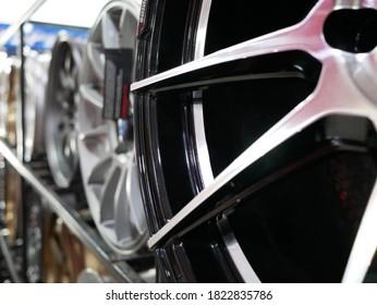 closeup of magnesium alloy wheel of car at garage.
