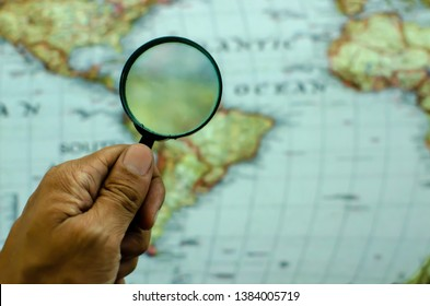 Closeup Magnifying glass ang map background for vission networking