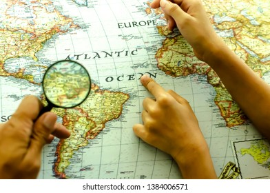Closeup Magnifying glass ang map background for vission networki