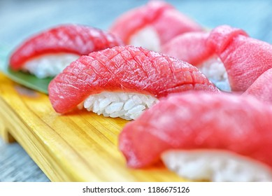 Closeup of Maguro Sushi on wooden plate.Healthy Japanese Foods in restaurant.Delicious dishes with copy space.Selective focus for design work.Raw Fish.Fresh Tuna Sushi.