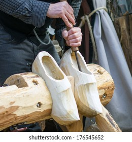 Close-up of the making of clogs, a traditional Dutch craft of making wooden shoes.