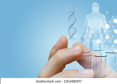 The closeup of male fingers holding a dna model and laboratory tubes with human figure image and medical service structure on the left. The concept of innovative researches.