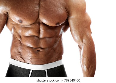 Closeup of male fitness man with high level trained body. Studio shot of strong bodybuilder posing over white background. Place for text. High resolution