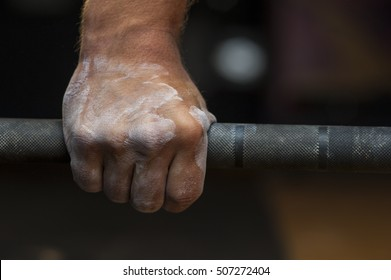 Closeup of male hand holding barbell. Weightlifting, power lifting or cross fit training.