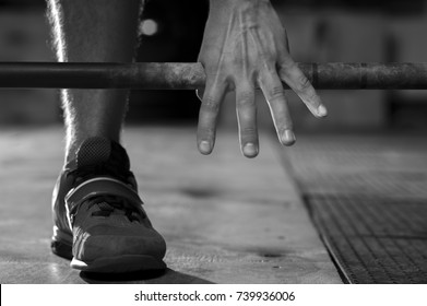 Closeup of male hand holding barbell. Strength training concept. Sports, fitness.