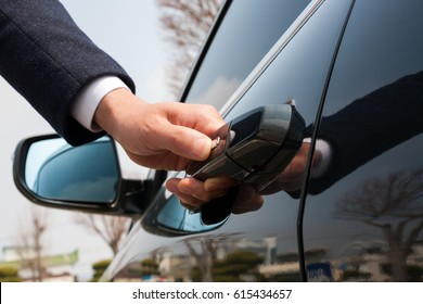 Close-up of male hand holding the car door/door for automotive/Car smart key