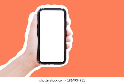 Close-up of male hand holding smartphone with mockup, isolated with white contour on orange background.