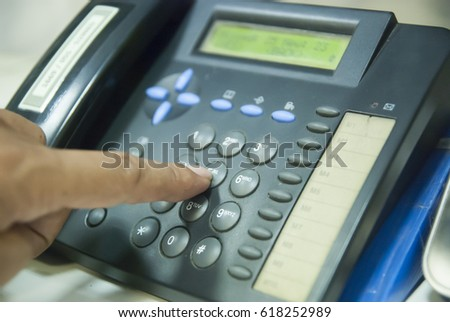 Closeup of male hand holding telephone receiver