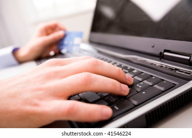 Close-up of male hand over black keyboard of laptop during typing